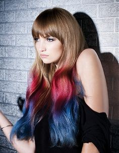 A long brown straight coloured multi-tonal red blue dip-dye hairstyle by L'anza