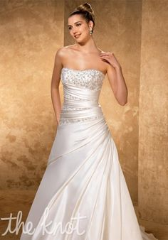 Gown features beading, matching wrap, and lace-up back.