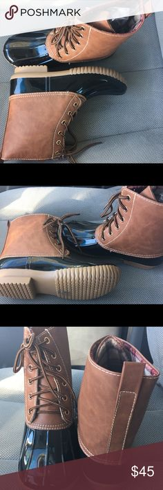 Dylan snow/ rain duck boots. Black/ Tan. NIB Very stylish and the hottest item of the season. Very nice neutral colors that will match everything in your closet. Man made materials. NO TRADES ADRIANA Shoes Ankle Boots & Booties