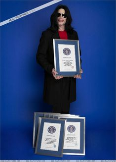 Michael receives the certificates for his 8 Guinness World Records at their headquarters in London November 14, 2006 in London, UK
