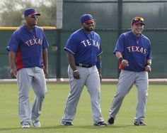 Texas' Adrian Beltre, Prince Fielder and Shin-Soo Choo are pictured during Texas Rangers baseball spring training in Surprise, AZ on Wednesday, February 19, 2014. (Louis DeLuca/Dallas Morning News) 62 Rangers vying for 25 roster spots.