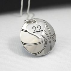 Perfect for a basketball fan or player, this pendant is a inch circle hand-stamped and domed to become a basketball. ONE small heart charm rests on top of it with the players number. Great gift for the players biggest fan! Basketball Mom, Basketball Necklace, Basketball Players, Basketball Girlfriend, Basketball Outfits, Basketball Quotes, Basketball Birthday, Basketball Wedding, Basketball Cookies