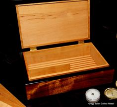 Small desk humidor. Solid Hawaiian curly koa wood, ebony lid liners, Spanish cedar interior with slotted ventilation separators. Custom boxes made to order. www.SalterFineCutlery.com