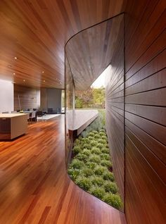 curved glass insertion offers unique window in this sleek house