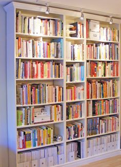Trickin out Ikea bookshelves!  Idea for odd room by living room... Make it a  Library study