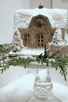 Village House on glass cake stand with pine boughs
