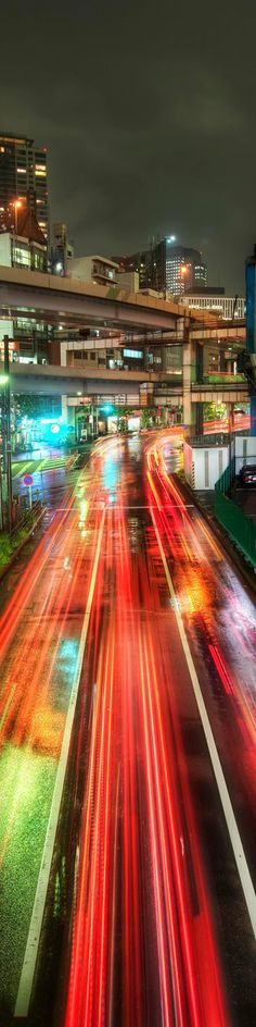The view of traffic at night with bright lights exerted by traffic lamp and vehicles makes the road colorful.
