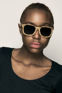 Sunglasses made from reclaimed zebrawood, made in Ghana.