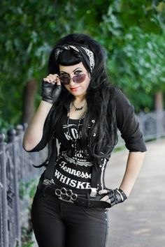 yes to this style - down to the details (scarf in hair, brass knuckle belt, leather gloves)