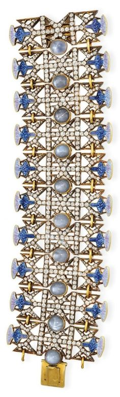 AN ART NOUVEAU GOLD, DIAMOND, STAR SAPPHIRE AND ENAMEL 'THISTLE' BRACELET, BY RENÈ LALIQUE, CIRCA 1900. Part of a parure which also includes a necklace and a brooch. With French assay marks and maker's marks, signed Lalique for René Lalique. #Lalique #Art