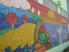 Awesome art mural with plastic bottle caps!