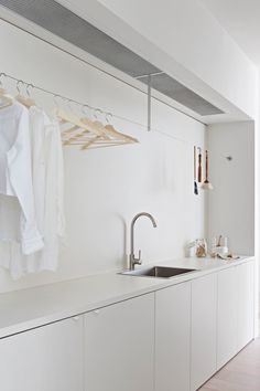 And, the editors' favorite feature of this sleek, streamlined laundry room is none other than a clever Ikea hack. See if you can spot it, then read more in Design Sleuth: One of the Most Ingenious Ikea Hacks Ever. Photograph by Shannon McGrath. Ikea Laundry Room, Modern Laundry Rooms, Laundry Room Organization, Ikea Utility Room, Storage Organization, Laundry Area, Small Laundry, Küchen Design, House Design