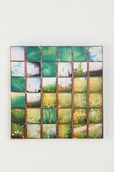 Very Cool DIY Wall Art   Take a 24x30 Canvas and 20 6x6 pics and organize them how you like then modpodge them onto the canvis... leave overnight and then take a roll of stained glass foiling tape and outline the photos!!