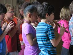 Grade 2 students perform on their flutes for the 8th grade students at the Rose Ceremony. 2014-15