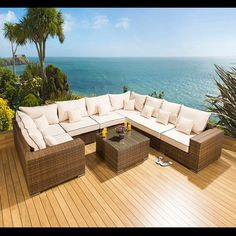 Luxury outdoor garden U shape corner sofa set/group brown rattan 25 brown. Truly stunning in design, this 4 seater corner sofa gives a super high-class feel. This set consists 2 x corner sofa pieces, 2 x end pieces, 3 x middle sofa pieces (2 x 850mm wide and 1 x 1250mm wide), a square coffee table + clips to hold them together, 8 x scatter cushions and heavy-duty covers in green. Call 02476 642139 or email sales@quatropi.com or visit www.quatropi.com for additional information.
