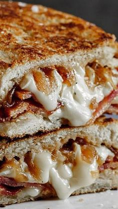 Crispy Bacon & Brie Grilled Cheese Sandwich with Caramelized Onions. We've just died and gone to heaven!