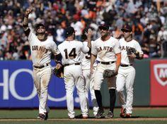 lincecumownsmyheart:  From left, San Francisco Giants' Gregor Blanco, Brandon Hicks (14), Hunter Pence and Tyler Colvin celebrate a 4-1 win ...