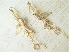 Gold Bird and Chains Earrings by marikaking on Etsy