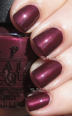Sleigh Ride For Two is a dark shimmery maroon. The shimmer while visible in direct sunlight was pretty much invisible in lower lighting.The PolishAholic: OPI Holiday 2013 Mariah Carey Holiday Collection Swatches