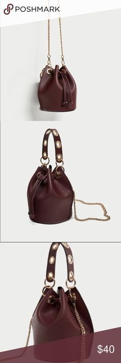 ZARA Mini Bucket Bag With Eyelets Metal hardware on the top handle, a detachable chain link shoulder strap, gold metal hardware and gathered drawstring closure at the top Color: Burgundy Zara Bags Mini Bags