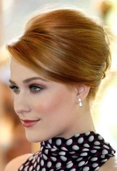 Classic eye makeup looks | usually a classic look refers to a simple look. Retro inspired updo for redheads. Polka dots  shirt.