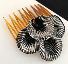 https://www.ebay.com/itm/Vintage-Hair-Comb-Antique-Silver-Tone-Ornate-Bridal-Prom-RARE-Never-Worn-13D/263559483086?hash=item3d5d5e8ece:g:XtYAAOSwNaRasDPV