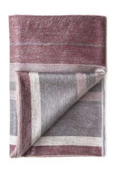 Cognac Alpaca Throw by Shupaca. All of Shupaca's products are hand woven on wood looms, using the same traditional methods that the artisans have used for hundreds of years.