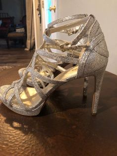 Michael Kors shimmering champagne platform stiletto.  Heel approximately 4 1/2 inches (see pictures) Never worn without tags.  No box