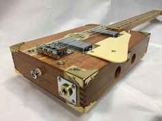 """The AVO-Classic has a 25"""" scale neck from oak, with a maple fret board and walnut fret markers, a 4 wood heal and 3 wood head stock, fretted to the 21st fret and has zero fret with bone nut, closed gear tuning pegs, body houses a pair of mini humbuckers run thru z telecaster 3 way, hard tail bridge, controls and bridge and strings are grounded, and finidhed off with chrome jack plate with brass color and strap buttons, gold colored corner caps, and pick guard, she is strung with nick..."""