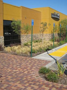 accessibility and water-efficiency create people welcoming spaces along the side of PF Chang's in Bakersfield, CA by Castle & Cooke