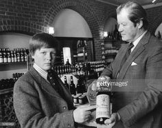 Charles Spencer, Viscount Althorp, (left), aged 13, only son of the 8th Earl Spencer, (right), in their cellar at Althorp House, Northamptonshire, with some of their own wine, which is available to the public. The Viscount's older sister Diana became the Princess of Wales.