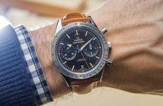Hands-on review & original photos of the Omega Speedmaster '57 watch with price, background, specs, & analysis.