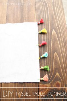 Jazz up a plain table runner with some DIY tassels. Perfect for a patio table in the summer!
