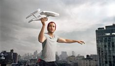 Chris Pine playing with a paper model of the Enterprise :).