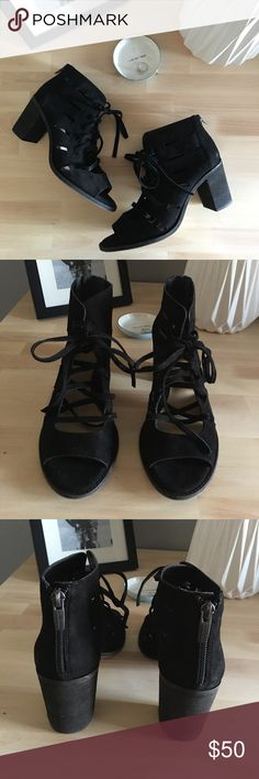 """VINCE CAMUTO Tressa Perforated Lace-Up Sandal GENTLY USED//SIZE 7.5//BLACK SUEDE  Breezy cutouts and an open lace-up front give one-of-a-kind appeal to an inventive open-toe sandal lifted by a smart, smooth heel.  3 1/2"""" boot shaft. Back zip closure; front lace-up ties. Lightly cushioned footbed. Leather upper/synthetic lining and sole. Made in Brazil. Vince Camuto Shoes Sandals"""