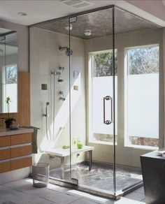 large glass shower enclosure with window
