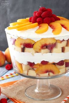 Peach Raspberry Sangria Trifle - peaches are soaked in white wine, then layered with raspberries, pound cake and fresh whipped cream! A light and easy summer dessert!