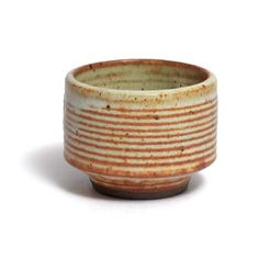 Yunomi Otto & Vivika   Red clay, beige glaze with rusty orange concentric rings. Top rim not perfectly round. 1992