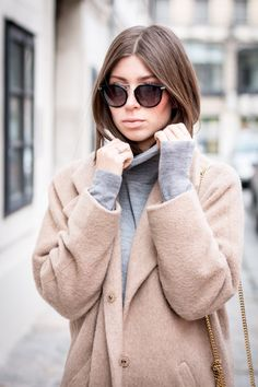 89a9b5d3084 Blogger Vicky Heiler wearing a grey turtleneck sweater - together with her ESCADA  sunglasses model