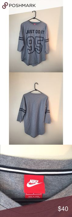 """NWOT Nike Top NWOT Nike 3/4 sleeve top! Black and grey with Nike """"Just Do It"""" slogan. Comfortable, slouchy fit. Never worn. Nike Tops"""