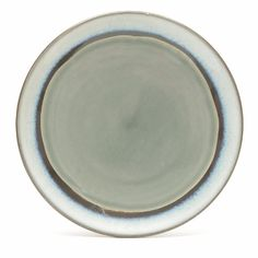 nkuku Dakara Ceramic Side Plate With Grey Crackle Glaze: The Dakara collection from Nkuku features a coloured crackle glaze centre with a bold brush stroke frame. This grey glaze side plate measures 20.5cm in diameter and 2.5cm high. The collection is great for everyday use as all items are dishwasher, microwave and oven safe. This plate is handmade and Nkuku is a company that seeks to ensure high ethical standards in the making of its products.