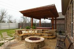 Relax by the gas lit firepit and in the  spacious hot tub.  Built in seating and lighted steps lead you into the hot tub with cedar pergola that includes a ceiling fan and trellis lighting.