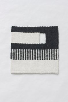 100% wool weft / 100% linen warp Black & off-white This one looks like a Mario Bros. door with light pouring through 8 x 8 inches Made by RinnTextiles - Erin Gilkes