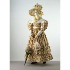 An 1828 floral printed cotton day dress and what is probably my all time favorite museum mannequin ensemble.  No one can put together an outfit quite like the Victoria & Albert Museum.