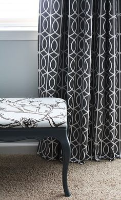 DwellStudio for Robert Allen Fabrics. Vintage Blossom Dove (chair) and Bella Porte Charcoal (drapes).