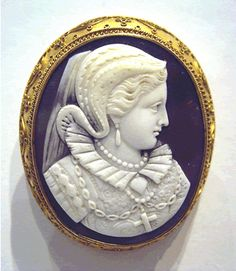 Chocolate brown Bull's Mouth shell cameo in a gold mount of the Scottish Queen, circa 1870. 5cm by 4cm, perfect.