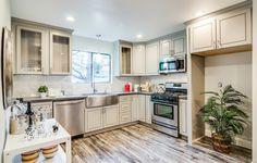 #Gray #Kitchen - Silestone Cemento Countertops - Kraus Stainless Steel Farmhouse Sink - Tokio Laminate hardwood flooring - Gazania Court - Next Generation Capital
