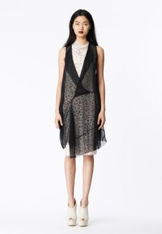 LOOK 6 Black chiffon asymmetrical sling dress over a white honeycomb lace cowl neck sheath.