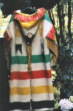 Hundson Bay Wool Blanket Capote Coat with or without deeskin fringe arms and back; hand beaded rosette on the hood - Capote Coats satrt at $425.00; fringed start at $475 Métis; metis