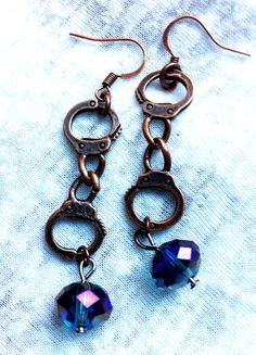 Wild West Bronze Handcuff Blue Crystal Earrings Fancy by Hankat, $10.00